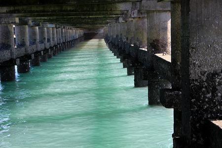 Under surface of bridge on sea at Bhet Dwarka off Dwaraka Coast in Gujarath, India, Asia