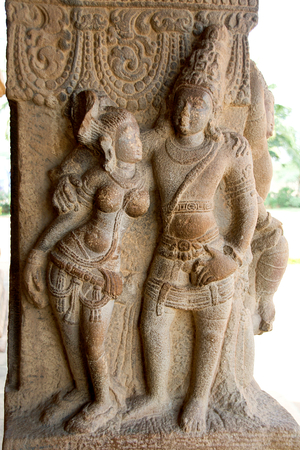 Graceful divine couple carved on stone pillar at Virupaksha Temple in Pattadakal, Bagalkot District, Karnataka, India, Asia Stock Photo