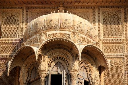 Close-up of intricate carving on canopy and surrounding wall at Patawon-ki-Haweli, Jaisalmer Fort, Jaisalmer, Rajasthan, India, Asia