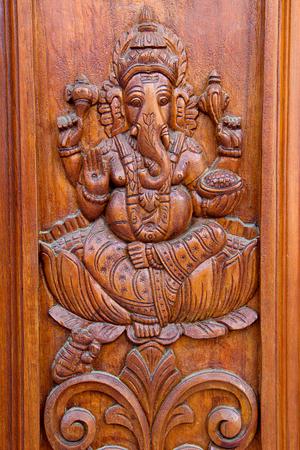 teakwood: Teakwood door panel with bas relief etching of Ganesha