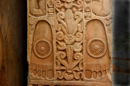 Beautiful carving of feet of Buddha with Chakra on stone pillar of Stupa at Sanchi, near Bhopal, Madhya Pradesh, India, Asia