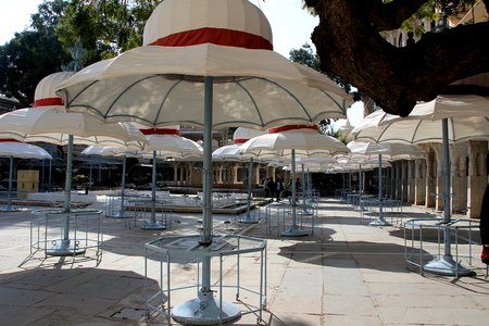 White domed umbrella stands in open dining area at City Palace in Udaipur, Rajasthan, India, Asia