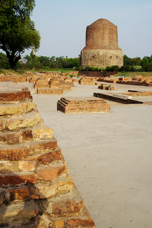 Dhamekh Stupa viewed along with traces of Buddhist structures  in foreground at Saranath near Varanasi in Uttara Pradesh, India, Asia