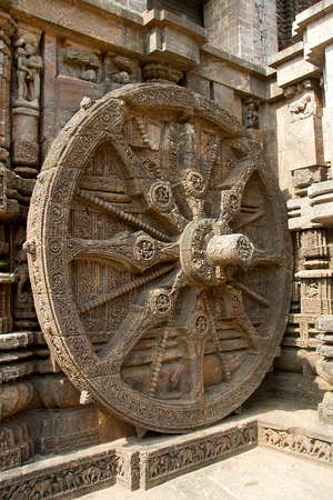 Detail of intricately carved stone wheel of chariot at Sun Temple in Konark, Orissa, India, Asia