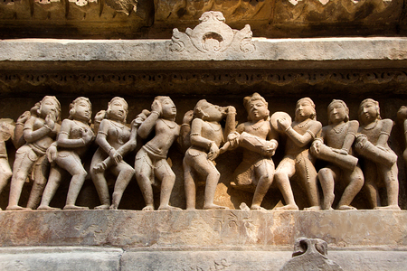 Statue of male, female in myriad moods sculpted on wall panel of Lakshman Temple, Khajuraho, Madhya Pradesh, India, Asia Stock Photo