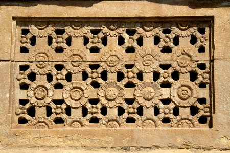 Artistically carved flower petals on stone window at Ladakhan Temple in Aihole, Bagalkot District, Karnataka, India, Asia Stock Photo