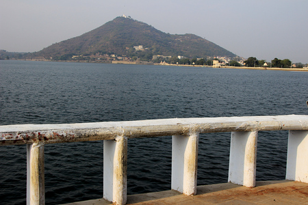 View of Fateh Sagar Lake, barricade on edge and hill beyond from Moti Magri in Udaipur, Rajasthan, India, Asia
