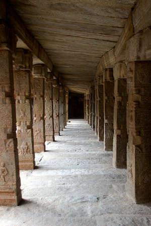 Lengthy corridor of stone pillars with interesting carvings at Veerabhadreswara Temople in Lepakshi, Andhra Pradesh, India. Asia