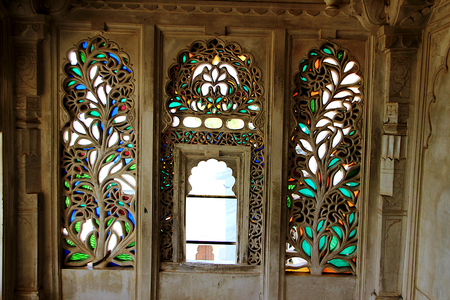 Intricate and decorative etching of floral design on window panes at City Palace, Udaipur, Rajasthan, India, Asia
