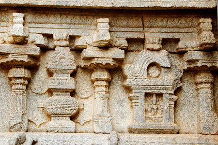 Decorative carving of pillars and deity on stone wall of Veerabhadreswara Temople at Lepakshi in Andhra Pradesh, India. Asia Redakční
