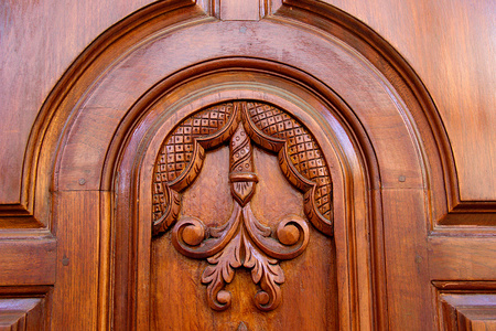 View of floral art and arch design on panel of wooden door