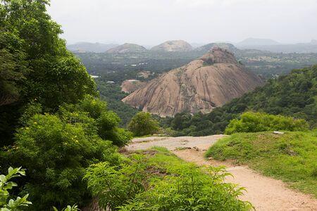 View of green foliage and rocks capes from top of Ramagiri Hill near Ramanagara, Karnataka, India, Asia