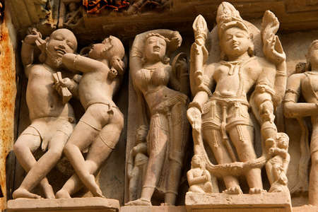 Carving of many moods on stone wall at Kandariya Mahadev Temple, under Western Group of Temples in Khajuraho, Madhya Pradesh, India, Asia