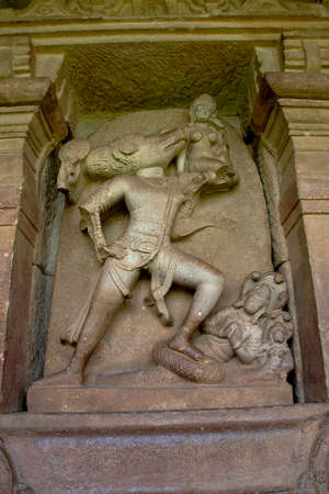 Stone sculpture Varaha lifting Bhoodevi at Durga Temple in Aihole, Bagalkot District, Karnataka, India, Asia Editorial