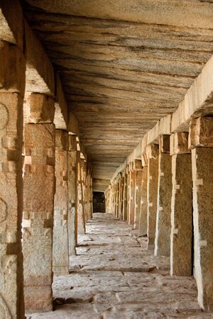 Perspective view of passage with stone roof, floor and columns at Veerabhadreswara Temple in Lepakshi, Andhra Pradesh, India, Asia