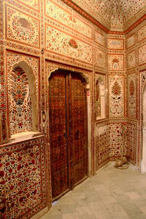 View of highly decorated wall and door design at Junagarh Fort in Bikaner, Rajasthan, India, Asia