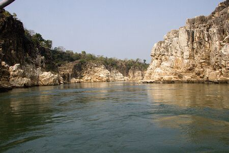 View of vast waters of Narmada River winged by Marble Rocks at Bedaghat near Jabalpur in Madhya Pradesh, India, Asia