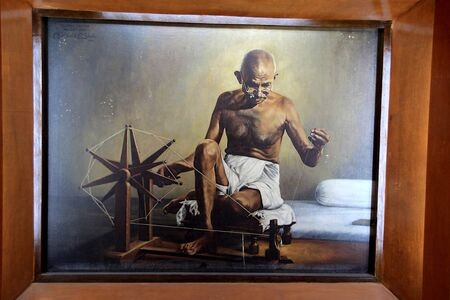 Portrait of Mahatma Gandhi weaving cotton thread at Sabarmathi Ashram in Ahmedabad, Gujarath, India, Asia