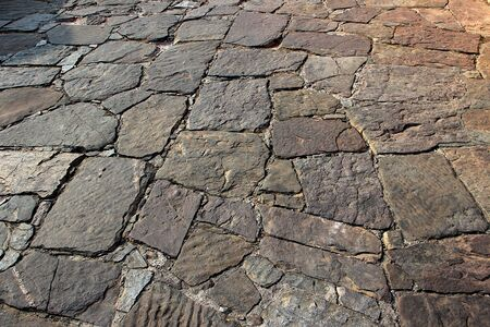 Flooring of neatly dressed and laid out stone slabs