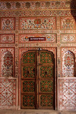 Exquisite floral design painted on wall and door at Junagarh Fort in Bikaner, Rajasthan, India, Asia