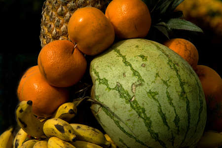 Arrangement of water melon, bananas, oranges and jack fruits in stack Stock Photo