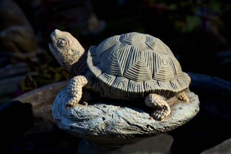 Artistic sculpture of land turtle with beautiful patterned shell made of cement concrete