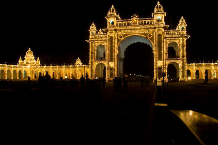 View of illuminated entrance to palace at Mysuru in Karnataka, India, Asia