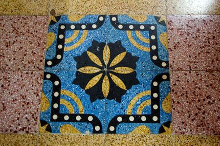 View of geometrical patterns in colour, grained mosaic floor tile design