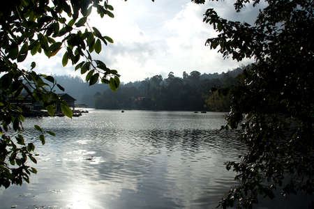 View of serene, morning, misty atmosphere of lake and landscape at Kodaikanal in Tamil Nadu, India, Asia Standard-Bild