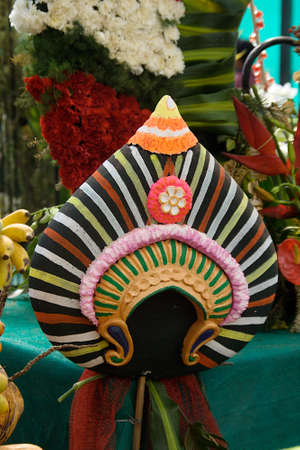 View of colourful and beautifully decorated head mask of Yakshagana character