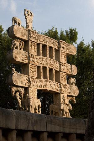 Sunlit torana at eastern gateway of Stupa at Sanchi, near Bhopal, Madhya Pradesh, India, Asia