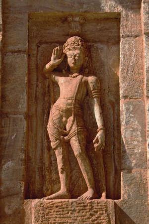Stone statue of saluting sentry at Kumaraswamy Temple in Nandihalli near Sandur, District Belllary, Karnataka, India, Asia