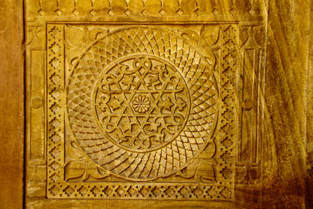 Close-up of intricate design on interior stone wall at Gwalior Fort in Gwalior, Madhya Pradesh, India, Asia