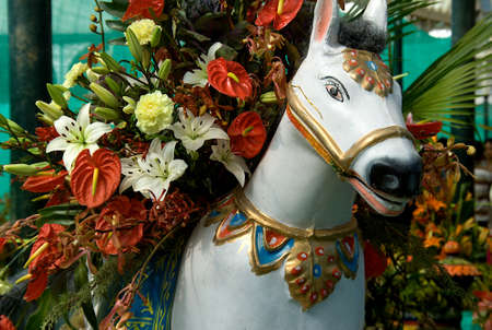 Close-up of plaster image of white horse laden with flowers at Republic Day Flower Show at Lalbagh in Bengaluru, India, Asia