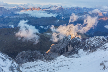 View from mount Marmolada on Dolomites in the evening sun
