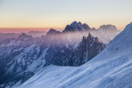 Panoramic view on rocky peaks of Aiguille du Midi at the sunrise. Chamonix, France. Scenic image of hiking concept. Perfect moment in alpine highlands.