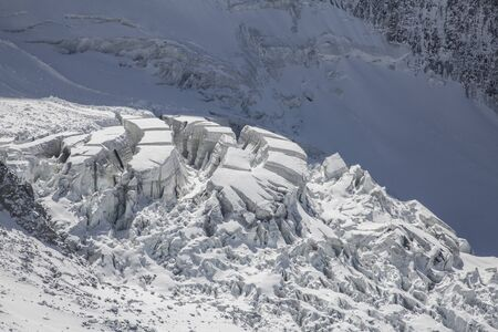 View on the Glacier de Bionnassay with huge crevasses. French Alps, Mont Blanc massif, Chamonix Mont-Blanc, France. Scenic image of hiking concept.