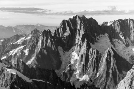Alpine peaks, rocks and stones of Mont-blanc massif view from Mont Maudit in the French Alps, Chamonix-Mont-Blanc, France. Scenic image of hiking concept Stock Photo