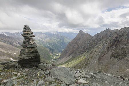 The stone pillar on a climbing route to Grossglockner rock summit in Austrian Alps, Kals am Grossglockner, Austria
