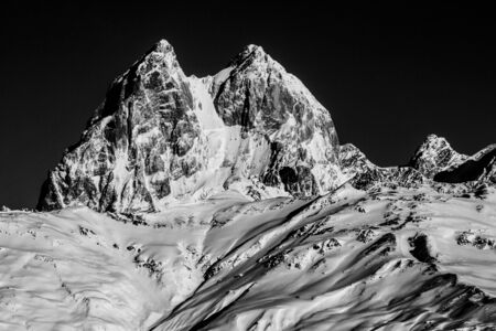 Black and white photo of double summit Ushba peak. Is notable mountain of the Caucasus Mountains located in the Svaneti region of Georgia, known as the