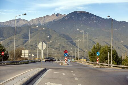 Road in the mountains. Lots of road signs and lights Stock Photo