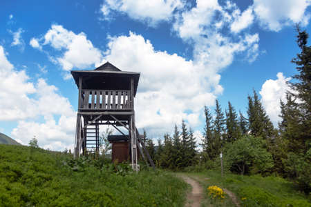 Tourist observation tower in the mountains. Walking vacation in the Carpathians Stock Photo