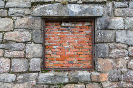Stone castle wall and bricked old brick window vintage background Stock Photo