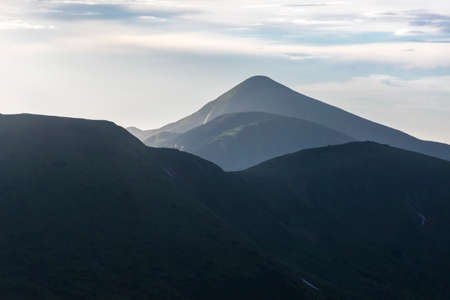 Summer landscape in the Carpathian mountains. View of the mountain peak Hoverla - is the highest mountain in Ukraine