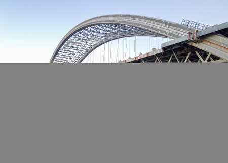 Huge construction of a new arch bridge across the Dnipro (Dnieper) River, Kyiv, Ukraine. Large infrastructure facility on the water