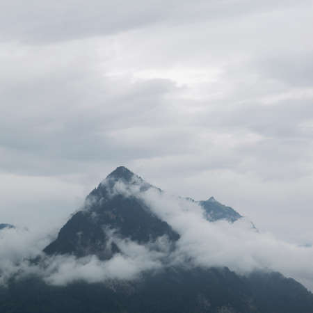 A fog and low clouds in the Alps, Grindelwald, Switzerland Stock Photo