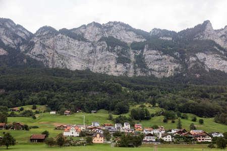 Swiss village between the mountains and cliffs, Switzerland