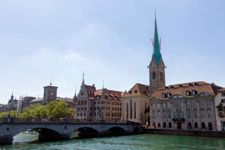 Panorama view of historic city center of Zurich with Fraumunster Church and Munsterbucke crossing river Limmat, Switzerland