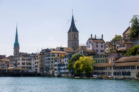 Cityscape of Zurich and river Limmat in daytime with blue sky, Switzerland Stock Photo