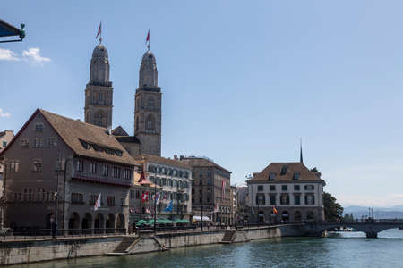 Zurich, Switzerland. View of the historic city center with famous Grossmunster Church, on the Limmat river. Stock Photo